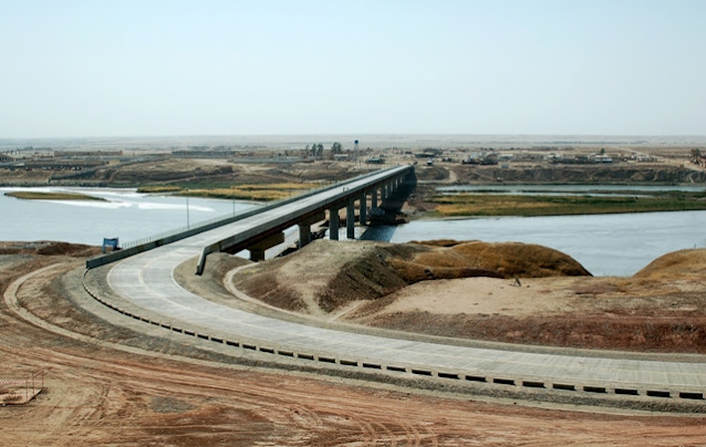 Image Attribute: The file photo of American-built Sher Khan Bandar crossing (opened on August 26, 2007), north of the city of Kunduz, fell to the Taliban on June 22, with 134 border guards and other Afghan government troops fleeing to neighboring Tajikistan. / Source: Wikimedia Commons