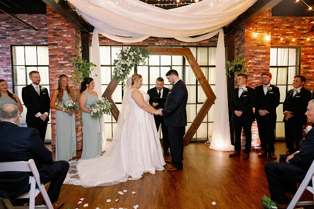wedding ceremony with hexagon arch