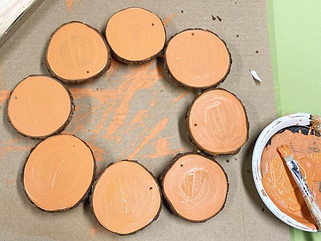 orange painted wood slices