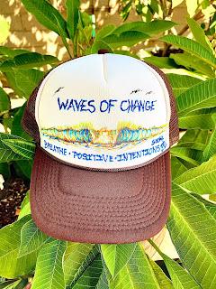 Painted hats by surfer shaper artist Paul Carter