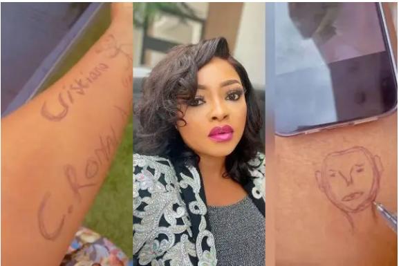 Nollywood Yoruba actress, Funmi Awelewa tattoos Cristiano Ronaldo on her laps (Watch video)
