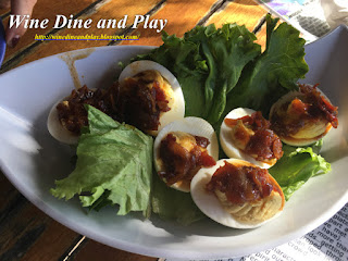 The deviled eggs at Woody's Waterside in St. James City, Florida is topped with a bacon jam and full of great flavor