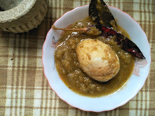 Egg curry in green tomato gravy