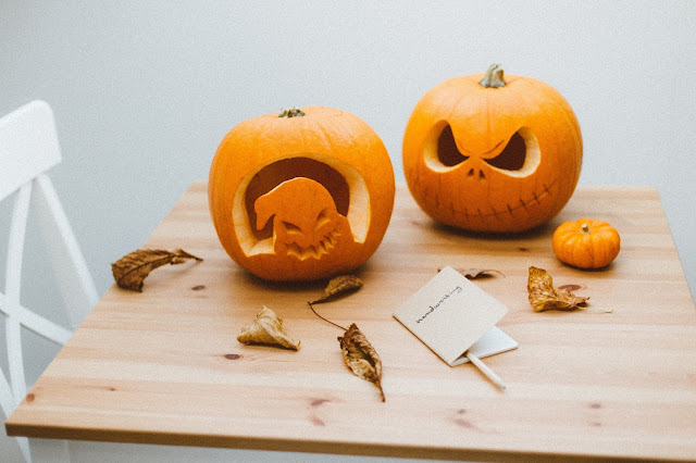carved pumpkins on table