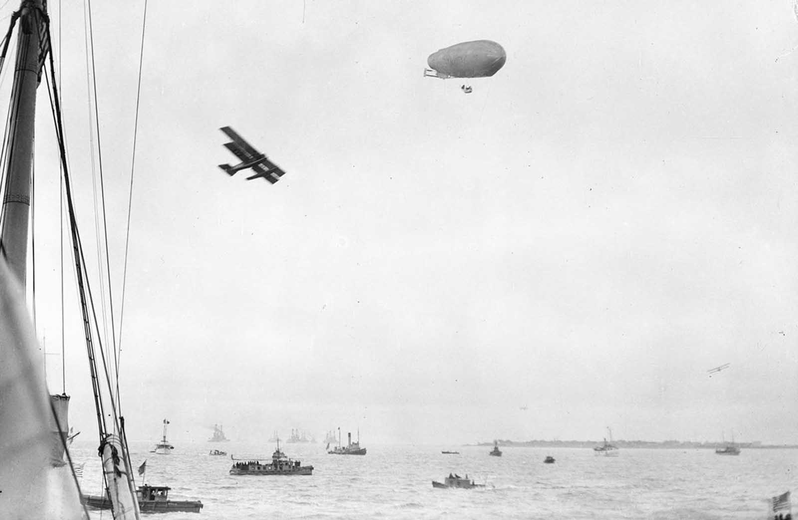 Boats, airplane, and airship, ca. 1922. Possibly the U.S. Navy's SCDA O-1.