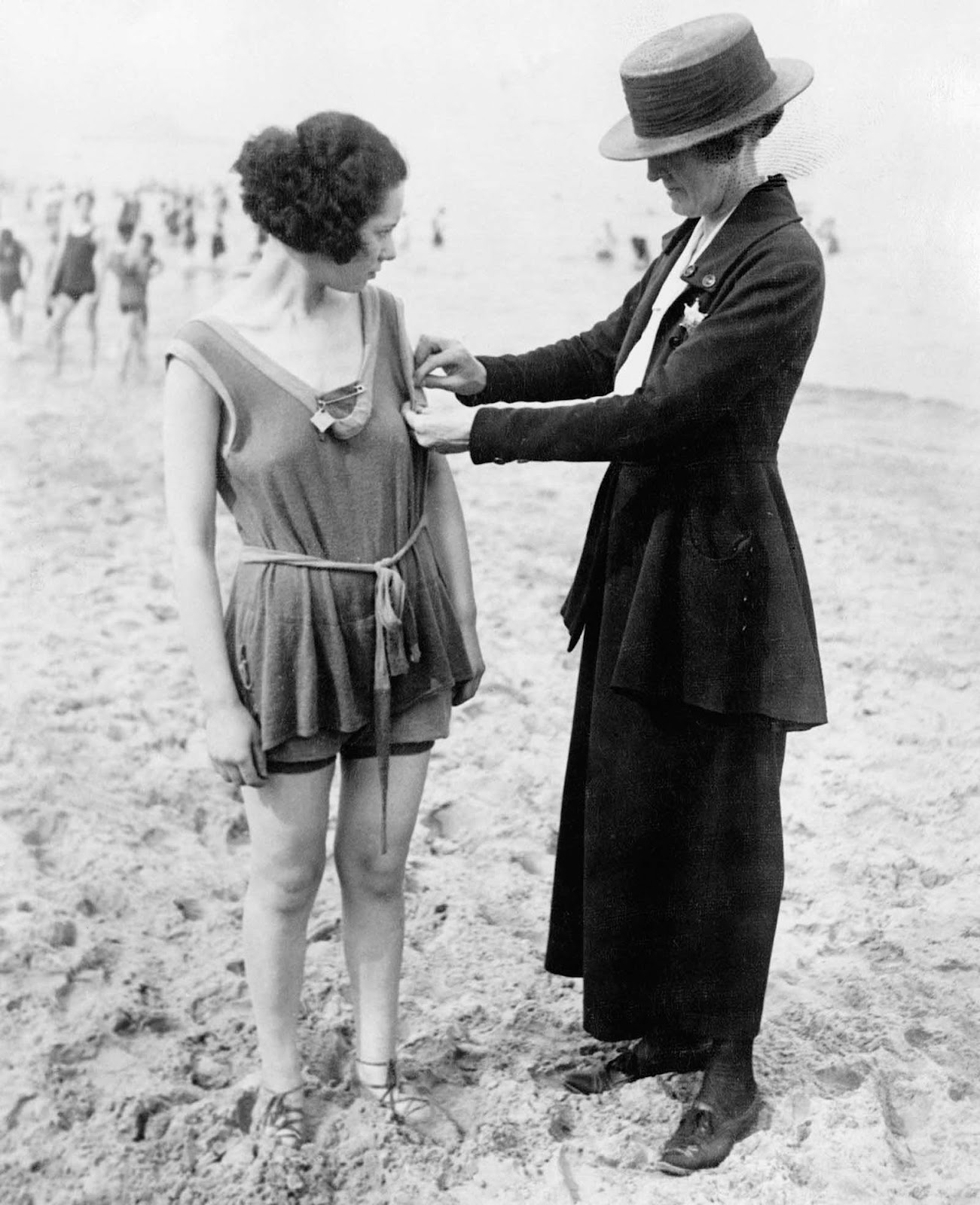Chicago policewomen checking for violations of the bathing suit-length laws. 1922.