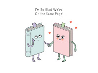 "Two books holding hands ""I'm glad we're on the same page"""