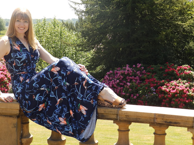 What Lizzy Loves over 40 blogger wearing Onjenu navy bird maxi dress