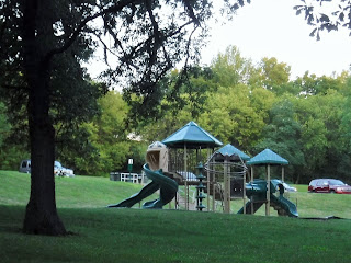 a khaki and green play structure at Bacon Creek Park