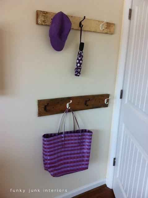 reclaimed lumber hooks behind bedroom door via Funky Junk Interiors