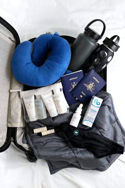 The Best Travel Products for a Long Haul International Flight - Travel Essentials and Must Haves, Gift Guide for People Who Like to Travel, What to take on a long haul flight, how to sleep on an international flight, how to sleep on a plane.
