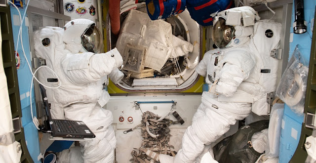 A pair of U.S. spacesuits inside the Quest airlock of the ISS. Credit: NASA