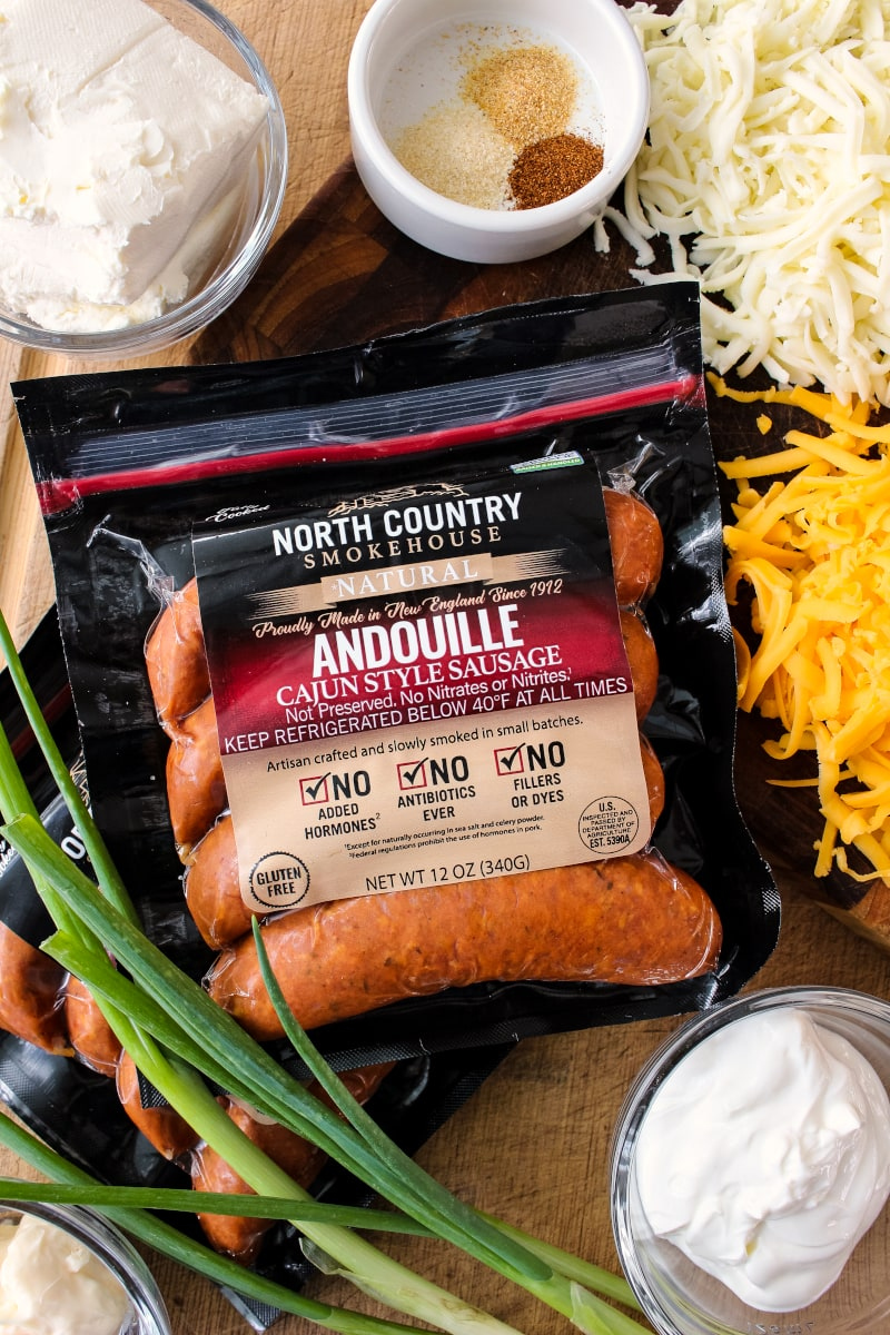 Cheesy Baked Andouille Dip is not your average sausage dip. It is creamy, super cheesy, easy to make, and full of bold Cajun flavor that will knock your socks off!  #northcountrysmokehouse #certifiedhumane #organic #superbowl #ad