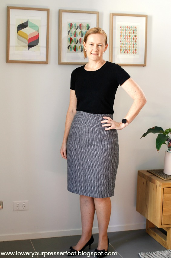 picture of a woman wearing a grey pencil skirt