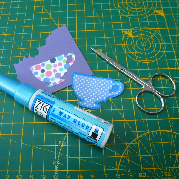 Layering the teacup garden tea cup die onto blue card from issue 176 of Simply Cards and Papercraft