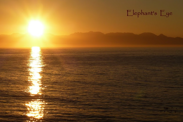 Sunrise across False Bay to the Hottentots Holland Mountains from Whale View Manor