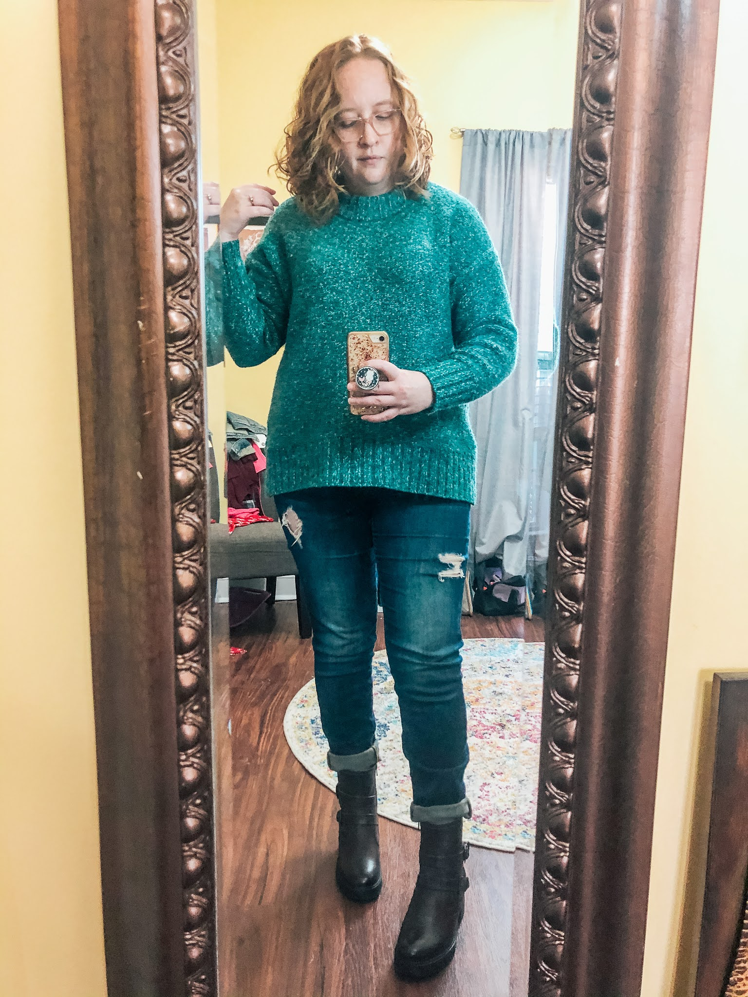 green-sweater-distressed-jeans-moto-boots
