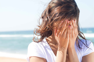 girl-covering-her-face-and-crying-near-sea-side-beach-HD-photo-image.jpg