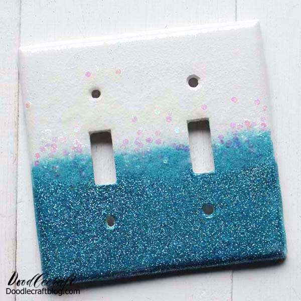 How to make a glittery light switch plate cover using glitter and resin!  Customize the color of glitter and top it off with High Gloss Resin for a smooth and shiny finish.  It's a simple DIY craft that just takes a few minutes of work time and overnight drying.