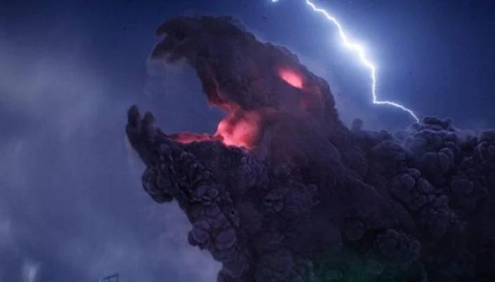 Imagem: Céu nublado com um  raio cruzando e um monstro feito de nuvens surge. Ele aparece uma espécie de dinossauro com a boca aberta e tem uma luz vermelha saindo de sua boca e de seu buraco onde seria o olho.