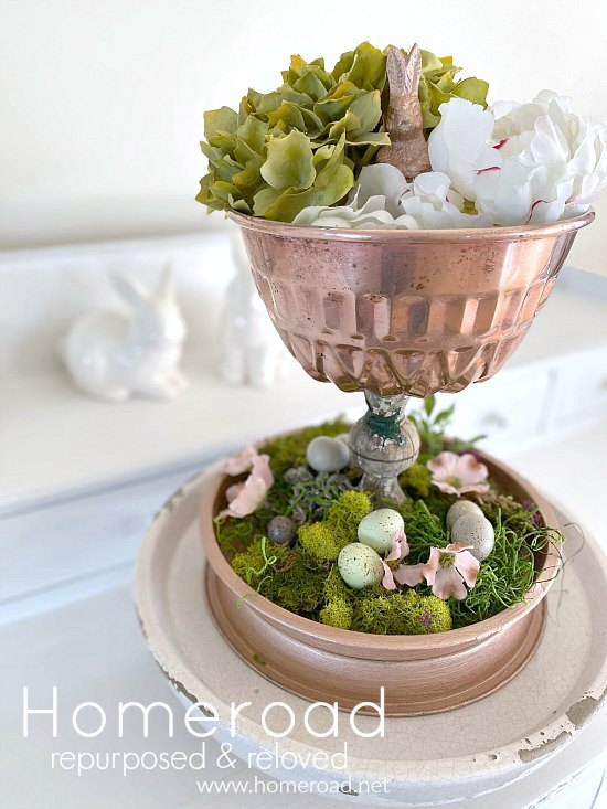 Easter tiered tray with moss and faux flowers and overlay