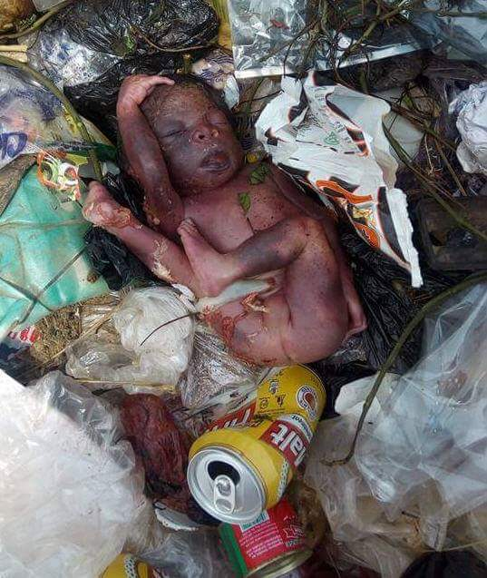 Graphic Photos: Body of newborn baby found dumped at refuse site around area populated by Nnamdi Azikiwe University students