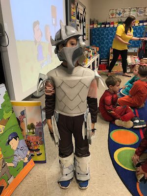 Young boy dressed as Shredder from the Ninja Turtles