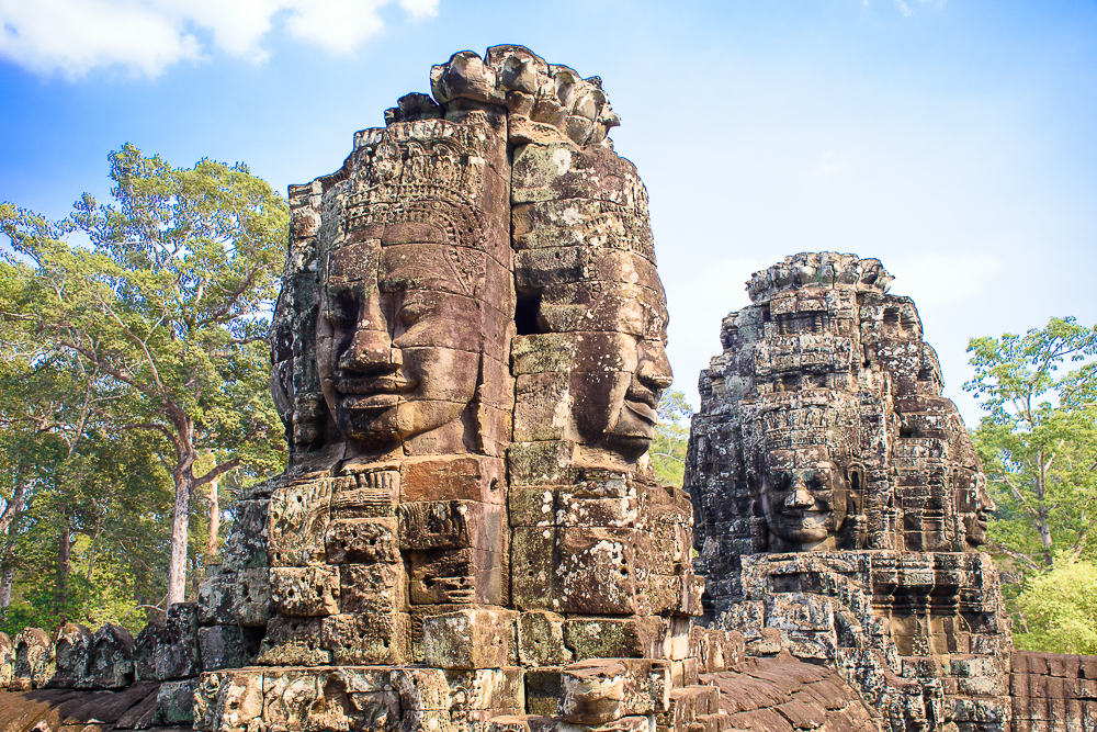 buddha heads on tomb raider filming site bayon temple, siem reap cambodia