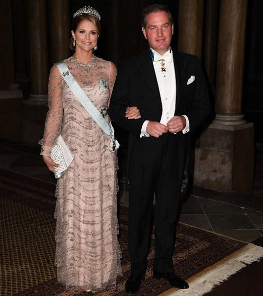 King Carl Gustaf and Queen Silvia hosted the traditional dinner for this year's Nobel winners at Royal Palace. Crown Princess Victoria, Prince Carl Philip, Princess Sofia, Princess Madeleine