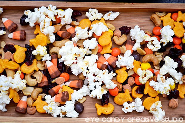 trail mix ingredients, popcorn, nuts, crackers, raisins, candies