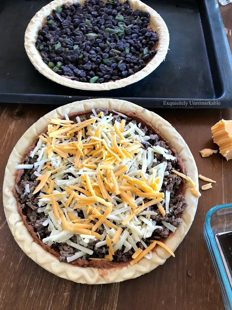 Black Bean and Meat Taco Pies on table