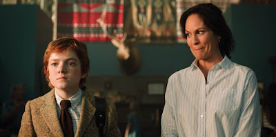 "Netflix's movie ""Rim of the World"" stars Jack Gore and Annabeth Gish stand and stare at summer camp."