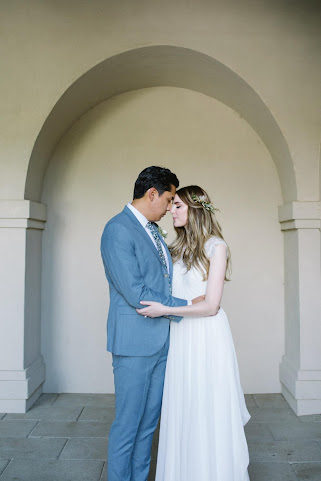 classic bride and groom portrait in an Italian style loggia for their garden wedding in utah