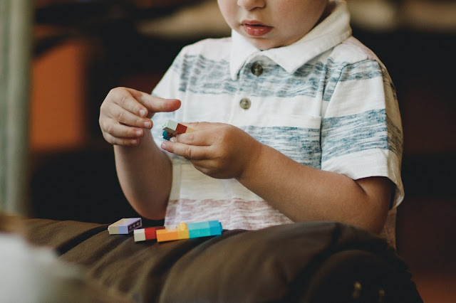 Photo by Caleb Woods on Unsplash boy plays LEGO