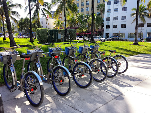 Check out Miami Beach's Citi Bike Program- so much better then driving--AND parking!