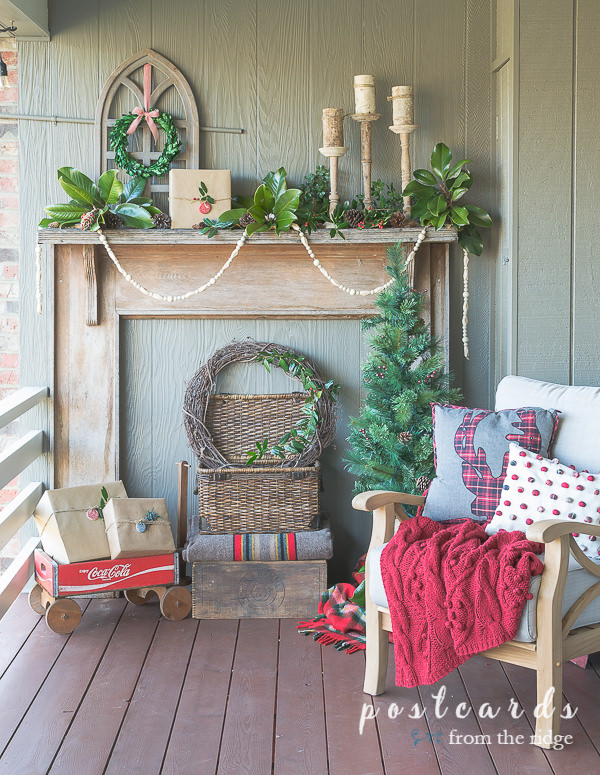 outdoor mantel with cathedral window frame and Christmas decor