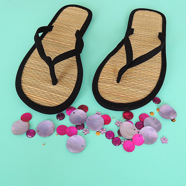 Black flip flops with pink and purple beads
