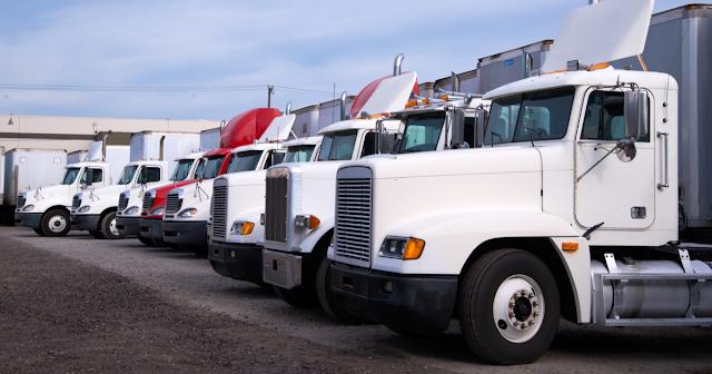 Trucks in a line using TruckLogics trucking payroll software