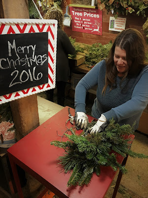Creating an unique wreath at the Carlson Tree Farm Christmas Wreath workshop