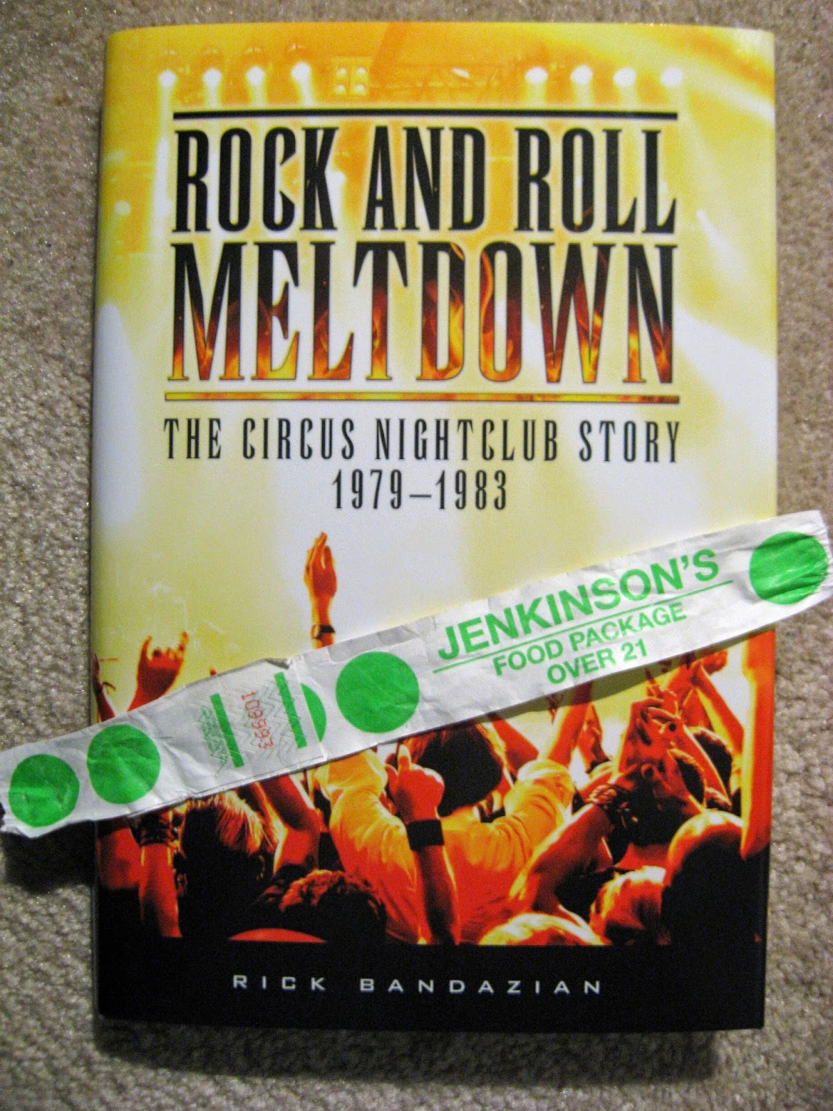 My copy of the book along with my wristband from the club from the event