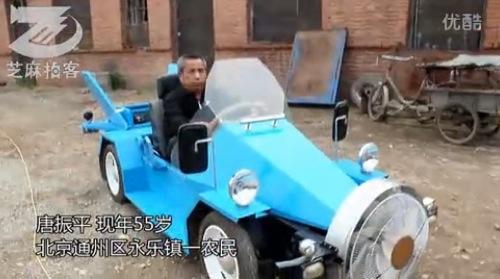 مزارع صيني يصنع سيارة تعمل بطاقة الرياح car.jpg