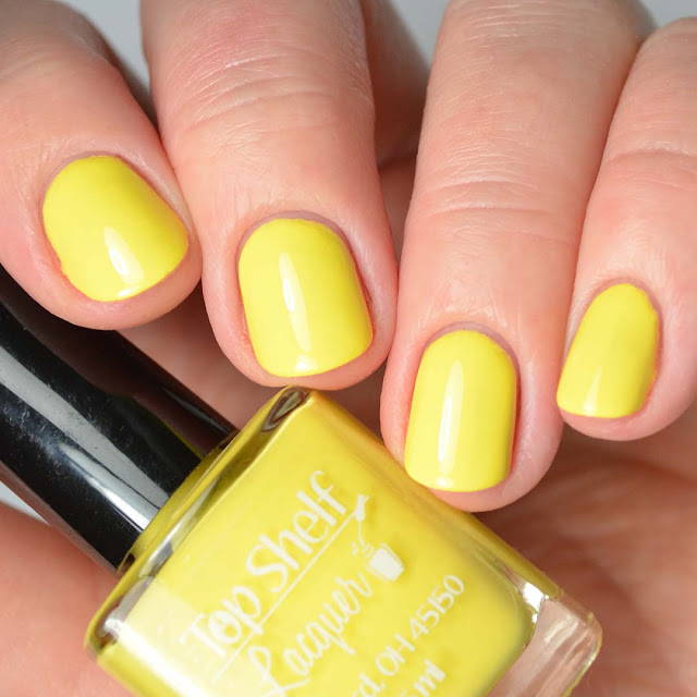 yellow nail polish four finger swatch