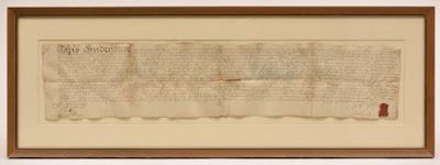 Framed 18th-century document - rectangular shape, written on vellum in iron gall ink