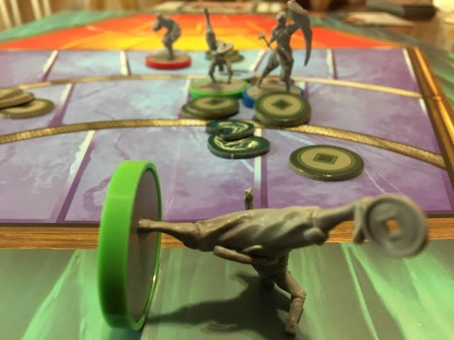 Bolin fails to carry his team after Mako and Korra get knocked out. Legend of Korra Pro-Bending Arena from IDW Games board game review by Benjamin Kocher. Photo by Benjamin Kocher