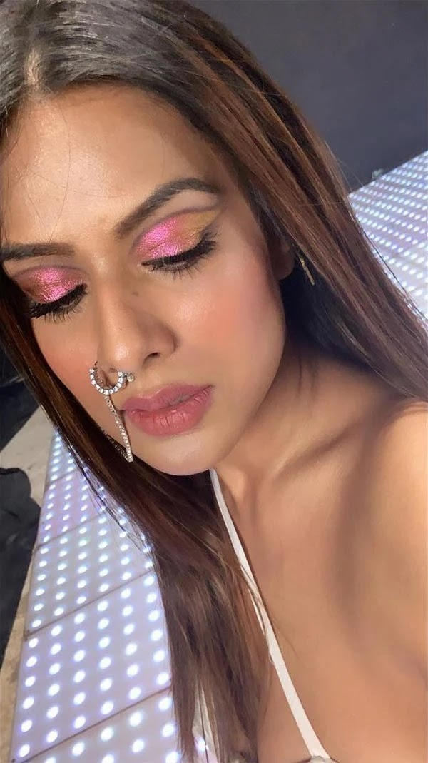 Nia Sharma looks sizzling hot in this sexy white outfit with a nose ring - Do Ghoont behind the scenes.