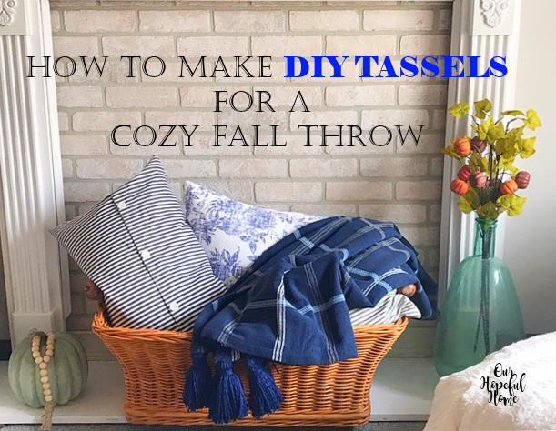 basket filled with pillows and throws in front of fireplace