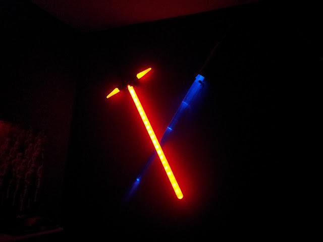 Crossed lightsabers as bedroom lighting.