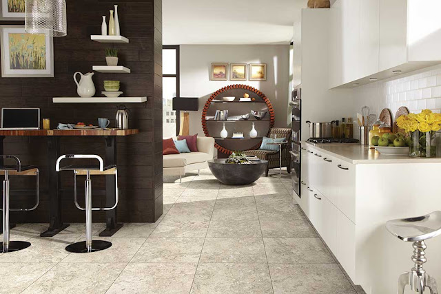 Luxury vinyl tiles look just like stone tiles in this bright, open space