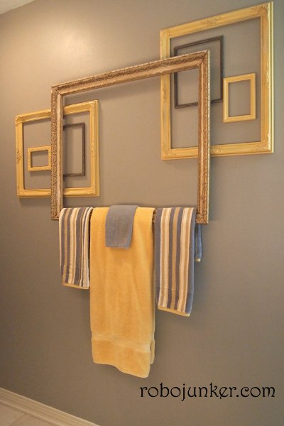 Repurposed frames into artsy towel holder.