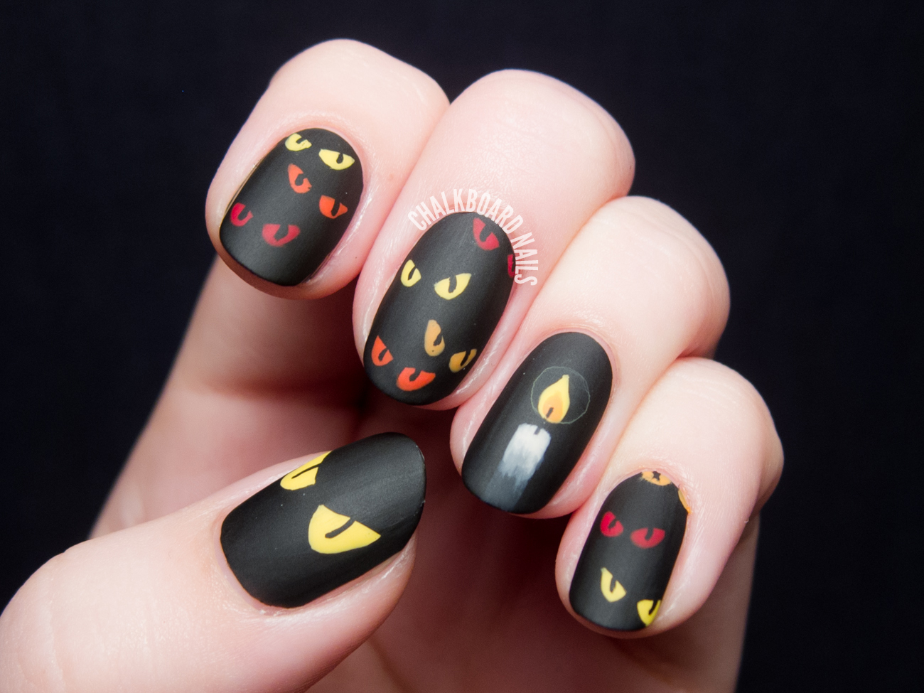 Spooky eyes nail art by @chalkboardnails